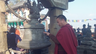 Monk reads inscription