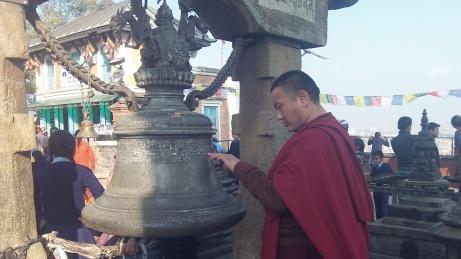 Monk reads inscription