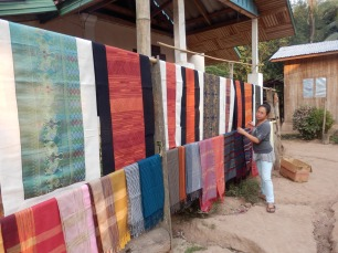 While I was at the still Angela was buy up half of Laos' cloth production.