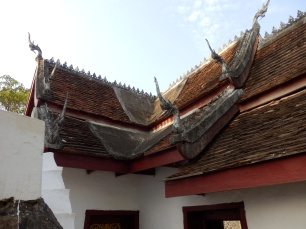 Intricate roof, it has something to do with not allowing bad spirits to rest on the roof.